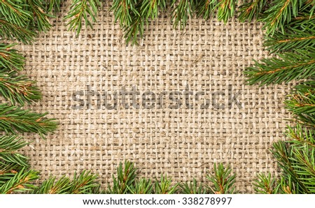 Christmas border from christmas tree branches. - stock photo