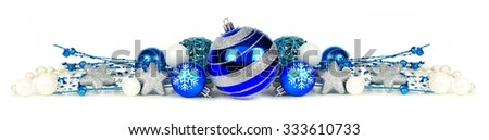 Christmas border of blue and silver ornaments and branches isolated on a white background - stock photo