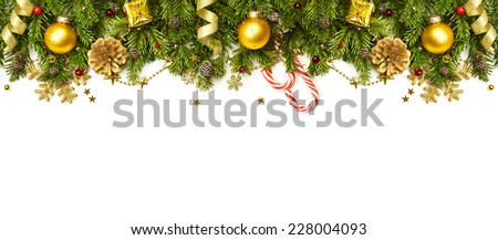 Christmas Border - tree branches with golden baubles, stars, snowflakes isolated on white,  horizontal banner - stock photo