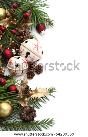 Christmas border with jingle bells and other Christmas ornaments and decorations isolated on white. Shallow dof - stock photo