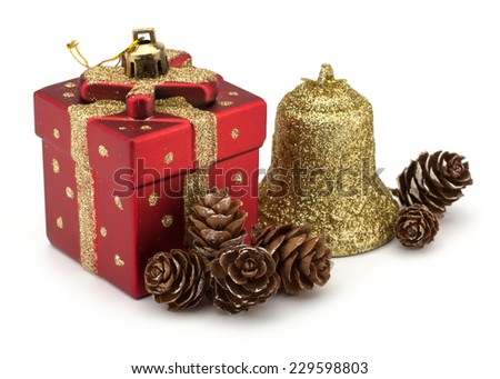 Christmas boxes, bell and pine cones decor isolated on white background - stock photo