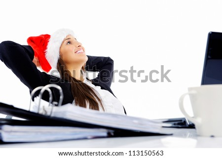 Christmas business woman daydreaming at her desk isolated on white background - stock photo