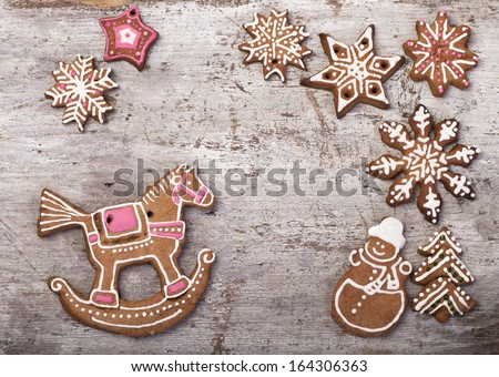 Christmas cake in the shape of a horse, Santa's sleigh, snowman, snowflake, glaze Gingerbread cookies  - stock photo