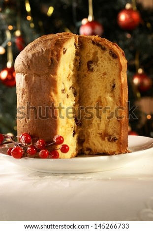 Christmas cake panettone and Christmas decorations. - stock photo