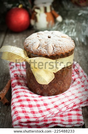 Christmas cake with almonds on the wooden table (panettone), selective focus, toned - stock photo