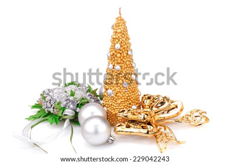Christmas candle, balls, ribbon and  flower decoration isolated on white background. - stock photo