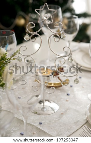 Christmas candle table setting  - stock photo
