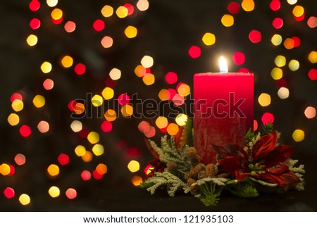 Christmas Candle with defocused background - stock photo