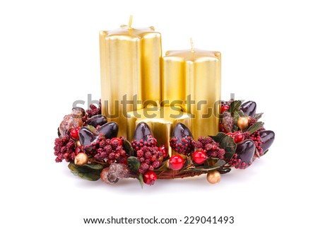 Christmas candles and decoration isolated on white background. - stock photo