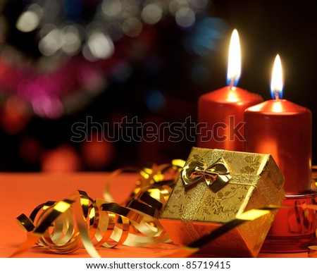Christmas candles and gift boxes. A celebratory composition - stock photo
