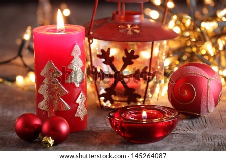 Christmas candles, lights and ornaments still life. - stock photo