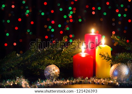 Christmas candles on dark background - stock photo