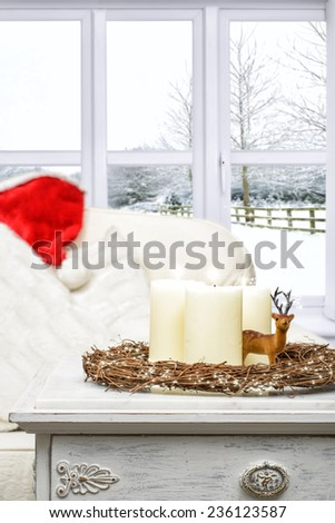 Christmas candles with winter snow scene window - stock photo