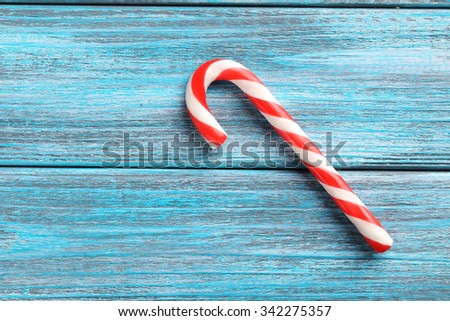 Christmas candy can on a blue wooden table - stock photo
