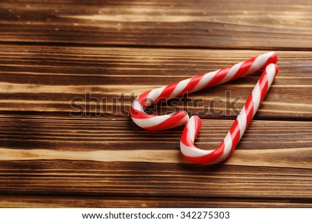 Christmas candy can on a brown wooden table - stock photo