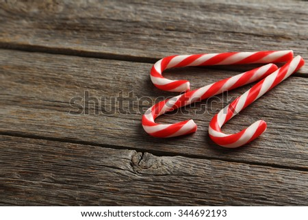 Christmas candy cane on a grey wooden table - stock photo