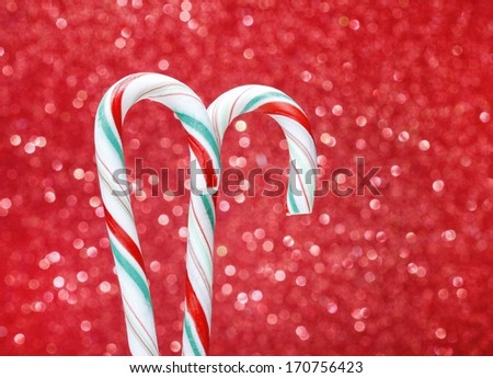 Christmas candy cane on red background. Traditional american lollipop. - stock photo