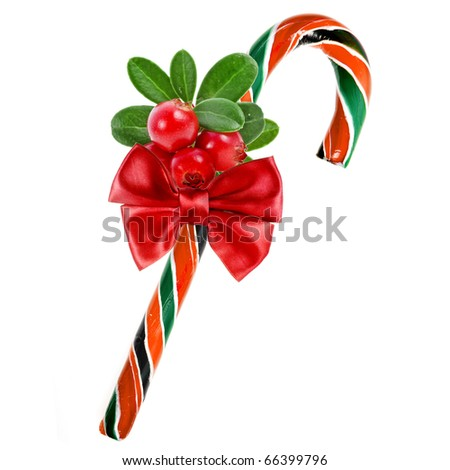 christmas cane with red berries isolated on white - stock photo