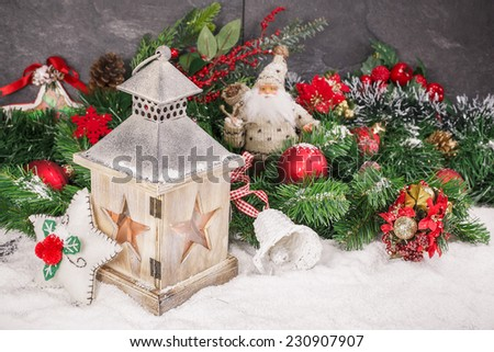 Christmas card. Christmas decoration and burning vintage lantern in snow.  Macro, selective focus. - stock photo