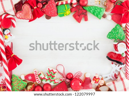 Christmas card /// Christmas decoration and cookies on white wooden background - stock photo