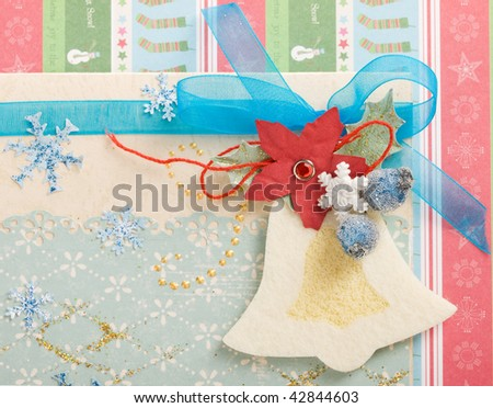 christmas card decorated with bell and snowflakes - stock photo