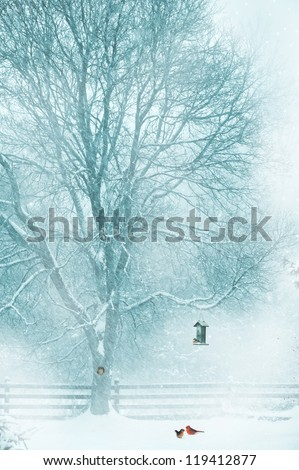 Christmas card design with a softly toned background with a pair of cardinals under the bird feeder in the snow, a little squirrel peeking out of his hole in the tree, and a chickadee on the feeder. - stock photo