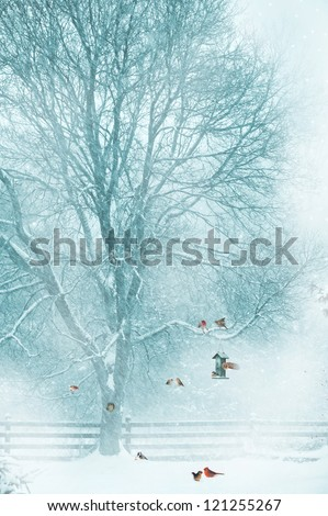 Christmas card design with birds  gathering around a bird feeder during a snow storm. - stock photo