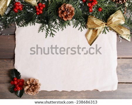 Christmas card on wooden background - stock photo