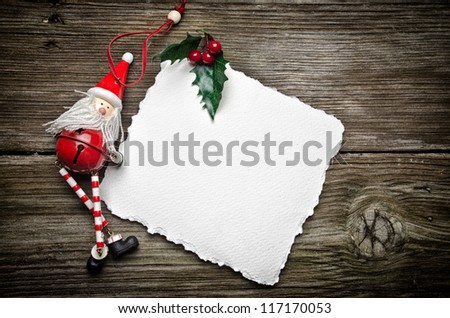 Christmas card on wooden top with christmas ornaments - stock photo