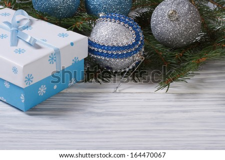 Christmas card with balls, gift box and spruce - stock photo