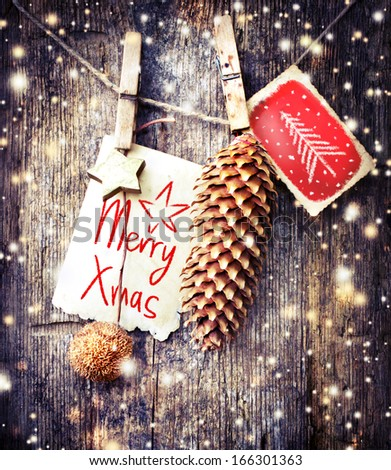christmas card with  christmas decorations and snow on wooden background - stock photo