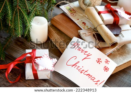 Christmas Card with Message Merry Christmas on the background of Christmas items - stock photo