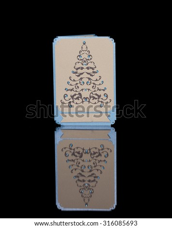Christmas card with ornamental fir tree on a black background - stock photo