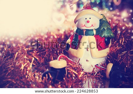 Christmas card with snowman. Christmas background with retro vintage instagram filter             - stock photo