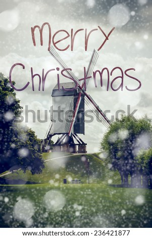 Christmas card with vintage windmill in background, retro style with cold tonne applied - stock photo