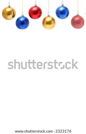 Christmas celebratory ornaments in the form of multi-coloured glass spheres above vertically - stock photo