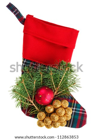 Christmas checkered stocking with fir branch, isolated on white - stock photo