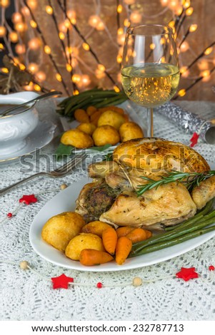 Christmas chicken dinner with roast vegetables - stock photo