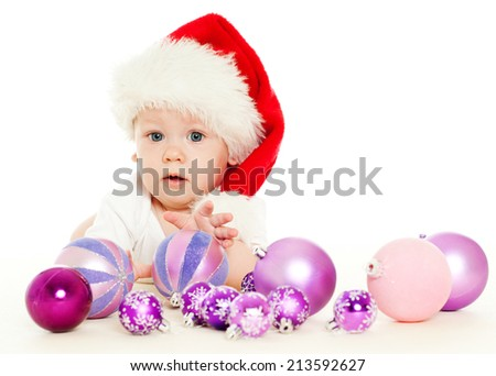 christmas child in a red hat - stock photo