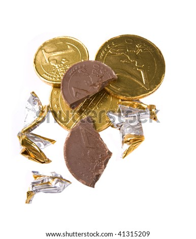 Christmas chocolate coins nibbled on - stock photo