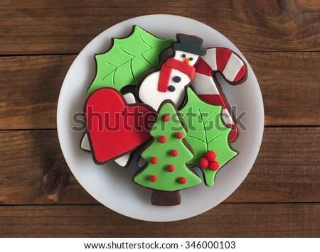 Christmas chocolate cookies on a white plate - stock photo