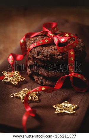 Christmas chocolate cookies tied with the ribbon - stock photo