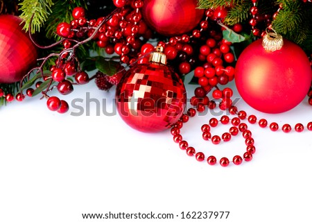 Christmas. Christmas and New Year Baubles and Decorations isolated on White Background.Holiday Border Design Composition with Christmas tree and Holly Berry. Red Color  - stock photo
