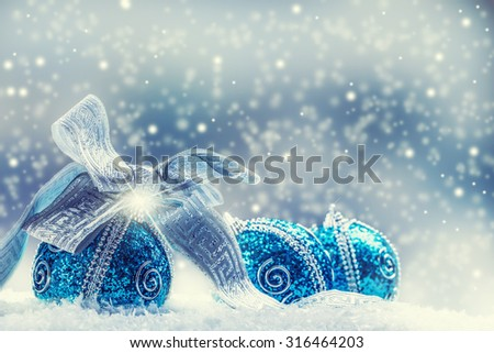 Christmas. Christmas blue balls and silver ribbon snow and space abstract background. - stock photo