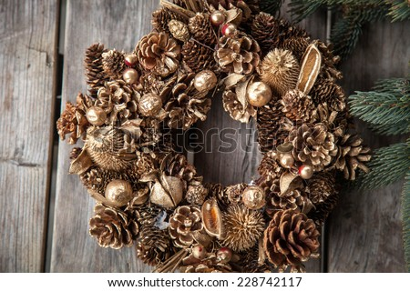 Christmas. Christmas time. Christmas wreath. Pine cones wreath. Evergreen. Wood. Wooden background.  - stock photo