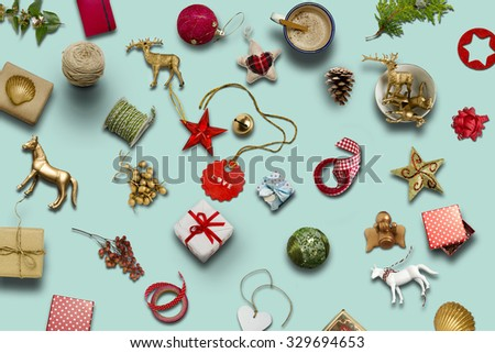 Christmas collection, gifts and decorative ornaments, on blue background. photographic montage - stock photo
