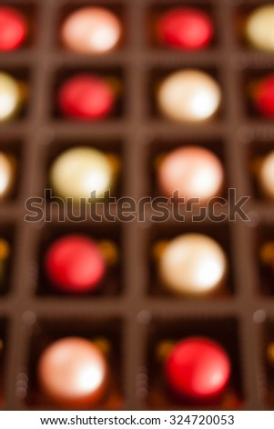 Christmas color ornaments background - Christmas color ornaments arranged in a tray. Defocussed for use as background. Natural light used. - stock photo