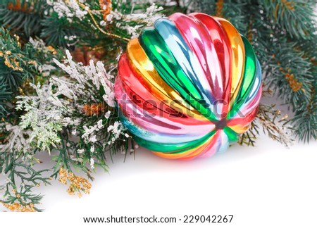 Christmas colorful ball, fir-tree branch on white background. - stock photo