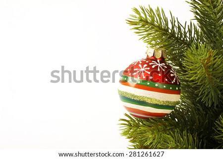 Christmas colorful ball on the Christmas tree on light background - stock photo