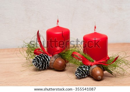 Christmas composition  candle, cones, acorns. on wooden background. - stock photo